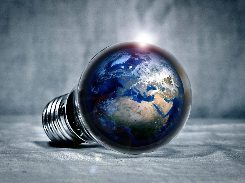 Light bulb containing the globe depicting global growth factor